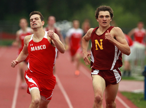 Masco's Alex Gikas, left, and Newburyport's Sawyer Updike, right, battle to a close finish in the 800 race on Wednesday afternoon. David Le/Staff Photo