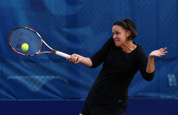 Former World No. 1 female tennis player and three time Grand Slam winner Lindsay Davenport, returns a volley against the Boston Lobsters while playing with the Orange County Breakers on Tuesday evening at the Ferncroft Country Club. David Le/Staff Photo