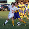 Masco's Alex Brown (3) left, fights his way around an Acton-Boxborough defender to win a loose ball. David Le/Salem News