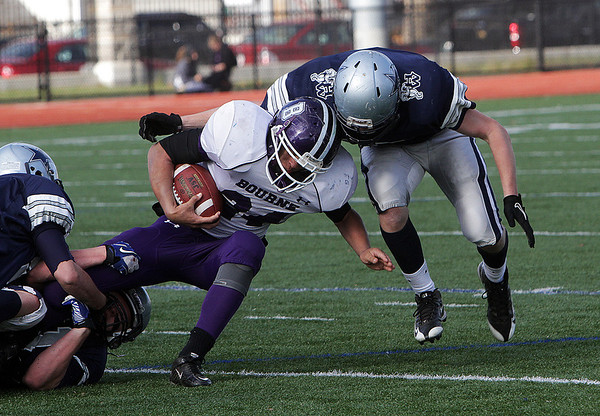 Hamilton-Wenham safety Christian Ecker right, puts his shoulder into Bourne High School's Marquesse Rhodes (24) on Saturday afternoon. David Le/Salem News