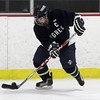 Pingree captain Shelby DiFiore controls the puck against Newton Day School. David Le/Staff Photo