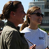 Salem: Emily Gardiner, left of Swampscott, and Katie Morgan, of Salem watch the opening ceremonies for the recently completed Harborwalk in downtown Salem on Thursday afternoon. The Harborwalk runs along the South River basin from Congress Street to Layfayette Street. Photo by David Le/Salem News
