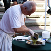 Salem: Chef Giovanni Grazziani of Caffe Grazziani, scoops his freshly made pesto into a mixing bowl at the Salem Farmers Market held in Derby Square on Thursday afternoon. Photo by David Le/Salem News