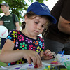 Madeleine Young, 5, of Beverly, makes colorful stamps on a flag she designed at the Beverly Homecoming Lobster Festival on Wednesday afternoon. David Le/Staff Photo