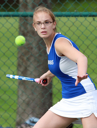 Danvers first singles player Rachel Ziner keeps her eyes on the ball while playing against Hamilton-Wenham on Friday afternoon. David Le/Staff Photo
