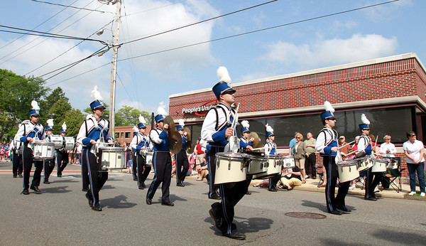 The Danvers High School drum line marches past People's United Bank near Danvers Square during the Memorial Day Parade on Monday. David Le/Staff Photo