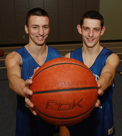 Danvers junior guards Jon Amico, left, and Eric Martin, right, will look to help the Falcons win the program's first D3 State Championship on Saturday at the DCU Center in Worcester. David Le/Staff Photo