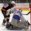 Beverly's Brenden Mitchell (10) left, flips a backhanded shot past Danvers goalie Stephen Wilkinson (25) right, en route to a 5-2 victory on Wednesday night. David Le/Salem News