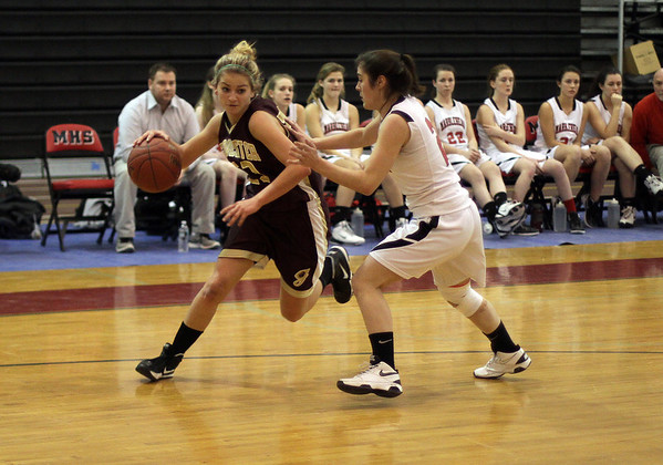 Gloucester's Heather Cain (23) left, drives to the hoop against Marblehead on Tuesday. David Le/Staff Photo