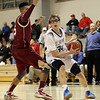 St. John's Prep point guard Tyler Dooley looks to pass around a BC High defender on Friday night. David Le/Salem News