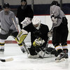 Peabody: Bishop Fenwick goalie Anthony Angelesco, center, stops a shot from a teammate at practice. David Le/Salem News