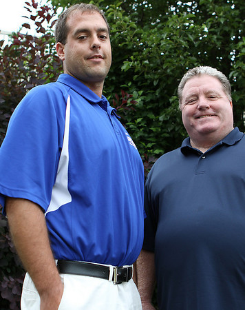Danvers: Newly appointed Danvers High School head football coach, Sean Rogers, left, poses with former head coach and current Danvers High Athletic Director, John Sullivan. Photo by David Le/Salem News