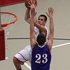Salem guard Billy Muse rises up over Danvers defender Nick McKenna (23) on Tuesday night. David Le/Salem News