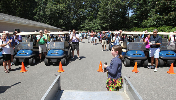Make-A-Wish child Lindsey Ashworth, 11, of Fairhaven, MA, gets a loud round of applause after she sang National Anthem prior to the start of the 20th Annual Make-A-Wish Massachusetts and Rhode Island Golf Tournament, held at the Salem Country Club in Peabody on Monday afternoon. David Le/Staff Photo