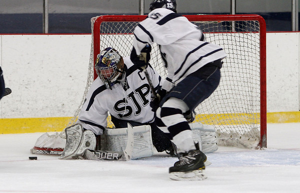 St. John's Prep senior goalie David Letarte (1) uses his stick to block away a shot. David Le/Staff Photo