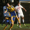 Masco's Alex Brown (3) right, collides with Acton-Boxborough's Andrew Bartow (3), left, in front of AB's net. Masco defeated AB on penalty kicks to advance.  David Le/Salem News