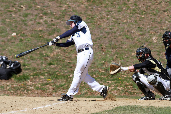 Peabody's Casey Grenier (3) makes contact with the ball against Bishop Fenwick on Saturday morning. David Le/Staff Photo