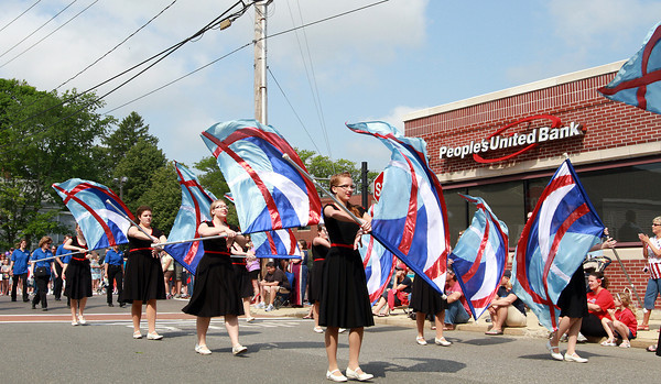 The Danvers High School Color Guard march past People's United Bank near Danvers Square during the Memorial Day Parade on Monday. David Le/Staff Photo