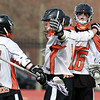 Beverly's Dom Abate (5) left, Ryan Shipp (1) center, and Justin Cole (26) right, celebrate a first half goal against Malden Catholic on Saturday afternoon. David Le/Staff Photo