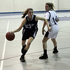 Swampscott's Niki Laskaris (23) drives to the hoop past Peabody's Katie Brunelle (14). David Le/Salem News