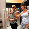 Andrea Avery, left, of Hamilton, and Elaine Howe, of Danvers, right, look at refrigerators inside Tri-City Sales on Friday afternoon. David Le/Staff Photo