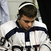 St. John's Prep sophmore Jack McCarthy (19) gets in the zone by blaring music through his headphones before the Eagles take the ice. David Le/Salem News