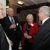 From left, Bill Howard, Dick and Diane Pabich, and John Hall talk at the annual Salem Partnership Holiday Party held at Finz Restaurant on Tuesday evening. David Le/Salem News