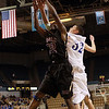 Danvers High School senior George Merry (32) right, battles for a rebound with St. Joseph's Joe Wiggins (32) left, on Saturday afternoon at the DCU Center in Worcester. David Le/Staff Photo