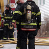 Peabody: Two firefighters discuss the next plan of action after extinguishing the blaze at 5 Hancock St. on Friday afternoon. David Le/Salem News