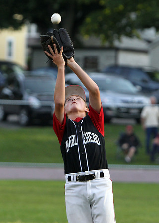 Marblehead starting pitcher Max Karass helps himself by catching a popup to the pitchers mound against Peabody on Tuesday evening in the Gallant Tournament final.