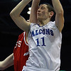 Danvers junior captain Eric Martin gets fouled as he goes up to the hoop against Saugus in the D3 North Final at the Tsongas Center on Saturday afternoon. The Falcons defeated the Sachems and advance to the state semi-final game at the TD Garden on Monday afternoon. David Le/Staff Photo