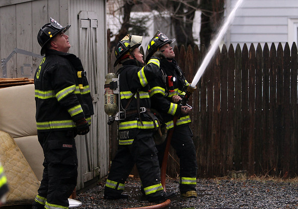 Peabody: Peabody and Salem firefighters work together to combat a 3-alarm blaze at 5 Hancock St. on Friday afternoon. David Le/Salem News