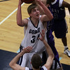 Gordon College fresman Hans Miersma (34) goes up strong to the hoop while being defended by two Curry players. David Le/Salem News
