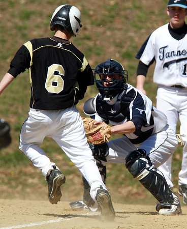 Peabody Catcher Genaro Ciulla, right, waits to apply the tag to Bishop Fenwick runner Alex Petras (6) left, at a play at home plate. David Le/Staff Photo