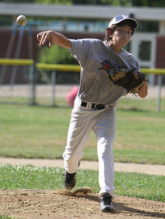 Middleton: Middleton Little League pitcher Andrew Marin throws batting practice to teammates at  their practice on Wednesday afternoon. The Middleton LL team plays its first game on Saturday in hopes of making it all the way to Williamsport. Photo by David Le/Salem News