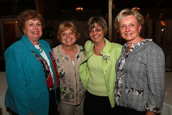 Beverly teachers from left, Dale Miller-Bouton, Kathy Woitunski, Pam Fall, and Janet McAskill, at a Celebration of Excellence, honoring retiring and new teachers, at the Danversport Yacht Club. David Le/Staff Photo