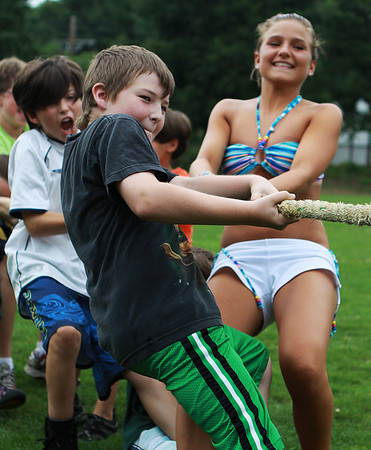 Beverly: From left, Ieuan Higgins, 11, Devin McCuish, 11, and Ayla Rawhala, 13, pull their team to victory in a tug-of-war contest as part of a field day for campers at the Artworks at Waring summer camp program. Photo by David Le/Salem News