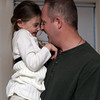 Marblehead: Sargeant Paul Atkinson, of Marblehead, shares a moment with his daughter Remington Tilkens, 6, after talking about Atkinson's suprise arrival home from his deployment in Afghanistan. David Le/Salem News