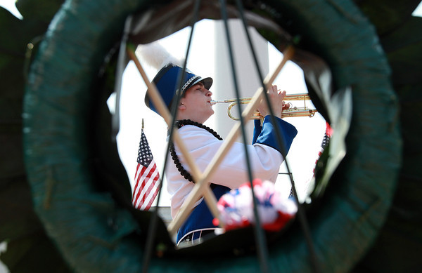Danvers High School freshman Patrick Berry plays Taps following the placement of a ceremonial wreath in Danvers Square during the Danvers Memorial Day Parade on Monday morning. David Le/Staff Photo