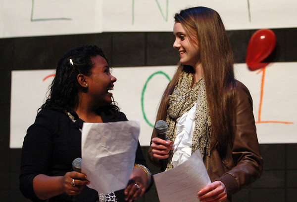 Collins Middle School 8th graders and emcees Stephanie Adorno-Martinez, left, and Jessica Reardon, right, tell a joke during the Middle School Talent Show on Thursday evening. David Le/Staff Photo