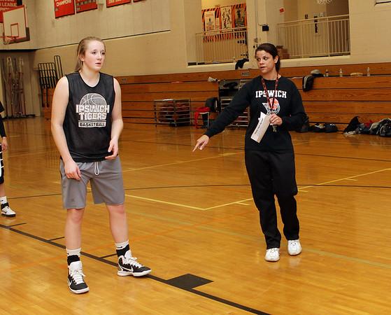 Ipswich head coach Mandy Zegarowski instructs Julia Davis, left, during practice. David Le/Salem News