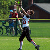 Marblehead left fielder Olivia Vener hauls in a fly ball to retire the side against Malden on Monday evening. David Le/Staff Photo