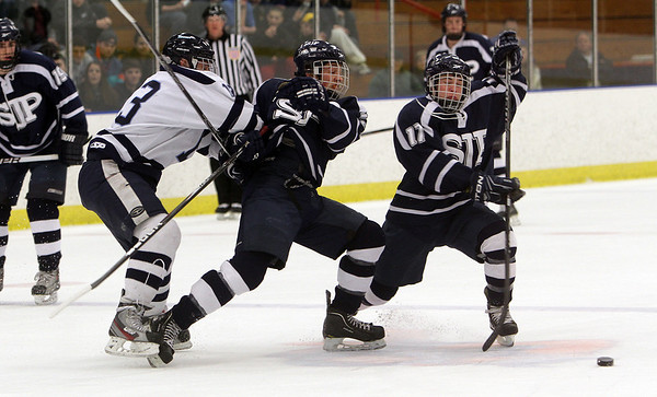 A few St. John's Prep players get tangled up with Peabody's Guiseppe Zarro (13) left. David Le/Salem News