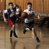 Spencer May, right, dribbles the ball on the breakaway against an opponent on Saturday morning. David Le/Salem News