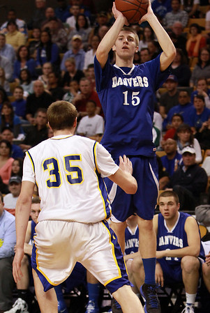 Danvers junior Nick Bates (15) rises up and shoots over Wareham's Jeff Houde (35) left, during the D3 State Semi-Final on Monday afternoon at the TD Garden. David Le/Staff Photo