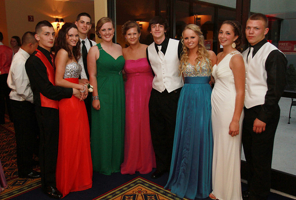 A group of Salem High School juniors pose for a photo at the junior prom at the Peabody Marriott on Friday evening. David Le/Staff Photo