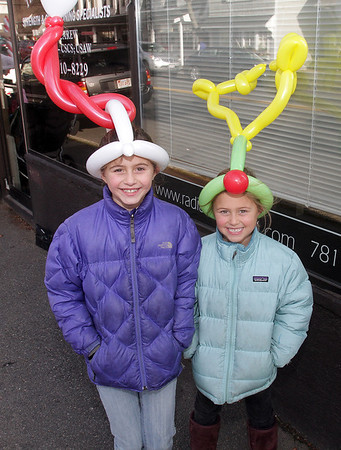 Sisters Emma, 9, and Isabelle Ferrante, 7, of Marblehead display some balloon hats that they got from Balloon-man Charlie Fogarty, of Gloucester. David Le/Salem News