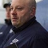 St. John's Prep assistant coach _____________ watches the action on ice. David Le/Staff Photo