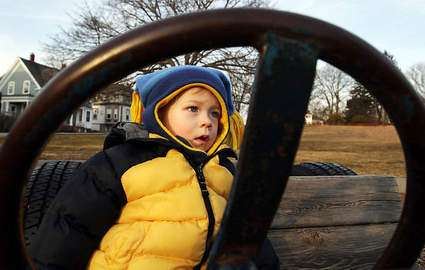 Andreas Harjula, 1, of Beverly, drives a playground wooden car on Tuesday afternoon. David Le/Salem News.
