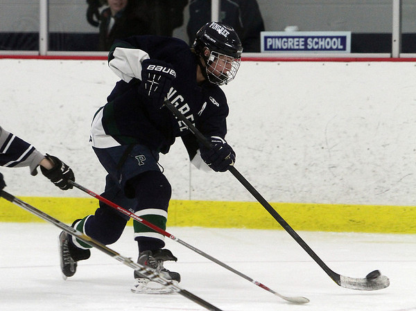Pingree senior Lily Sabatini rips a shot on net against Newton Country Day School. David Le/Staff Photo